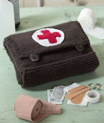 Free knitting pattern for First Aid Kit - Nancy Anderson designed this vintage-style first aid kit with two expanding pockets for Red Heart Cares. 8 x 8 x 3 inches. Great housewarming gift.