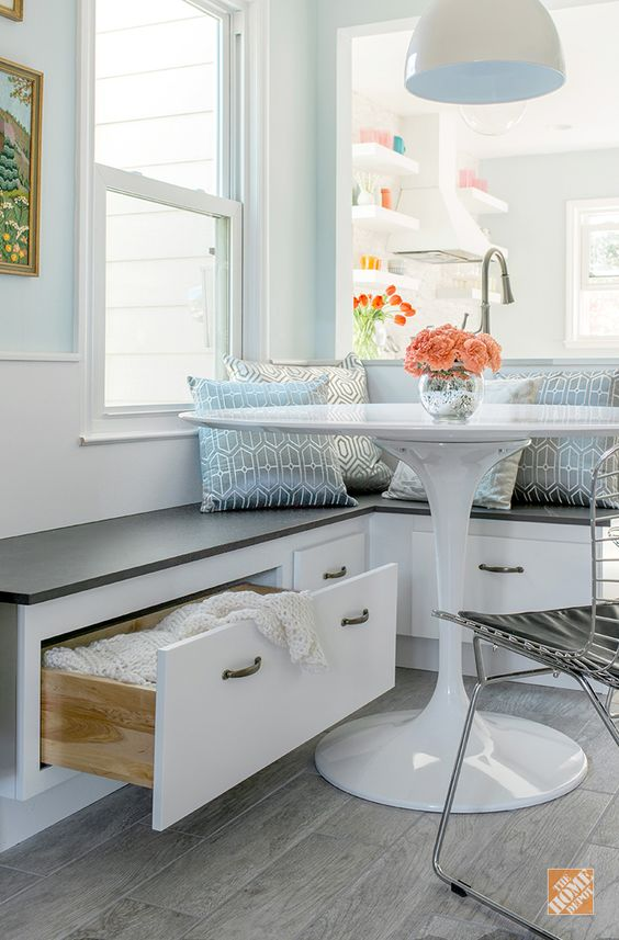 This custom kitchen banquette provides comfortable seating and extra storage. It also opened up some of the floor space in blogger Joni Lay's kitchen makeover. Joni has more on this kitchen remodeling project and the design choices that turned her small space into a dream kitchen.: