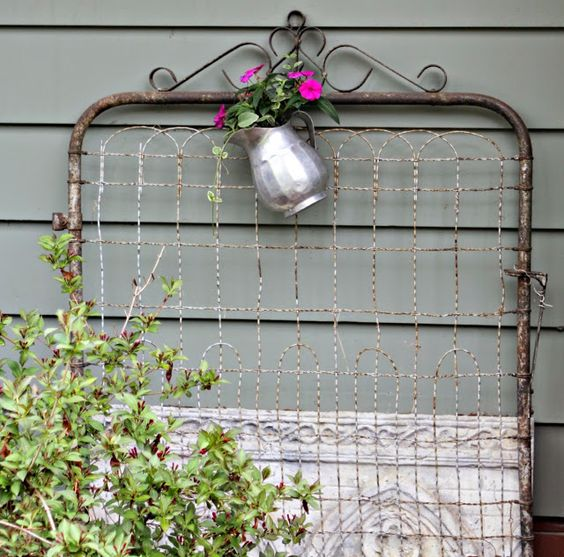 Repurposed And Upcycled Farmhouse Style Diy Projects: Old Wire Gate & Metal Pitcher . . . Planter, Back Patio