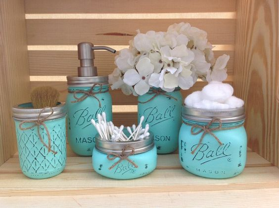 Turquoise mason jars to store bathroom essensials by the for Bathroom decor with candles