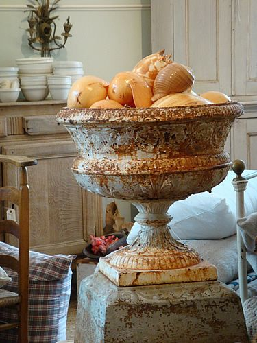 Red Chair Antiques, Hudson, NY. Antique urn with shells. French Farmhouse White Decorating Ideas.