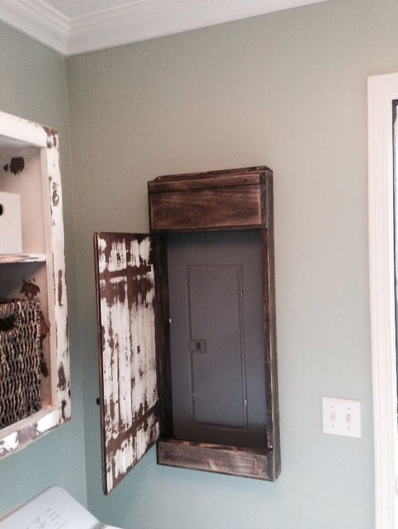 My hubby made this sweet distressed door cover for the electrical panel in our laundry room.