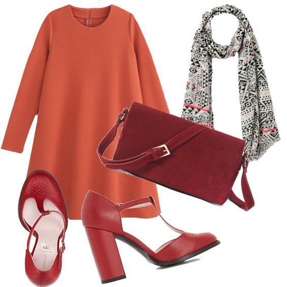 Questo vestito sbarazzino, che riprende il colore del le foglie dell'acero, è indossato con scarpe alte e coloratissime, borsa in tinta e una sciarpina leggera.