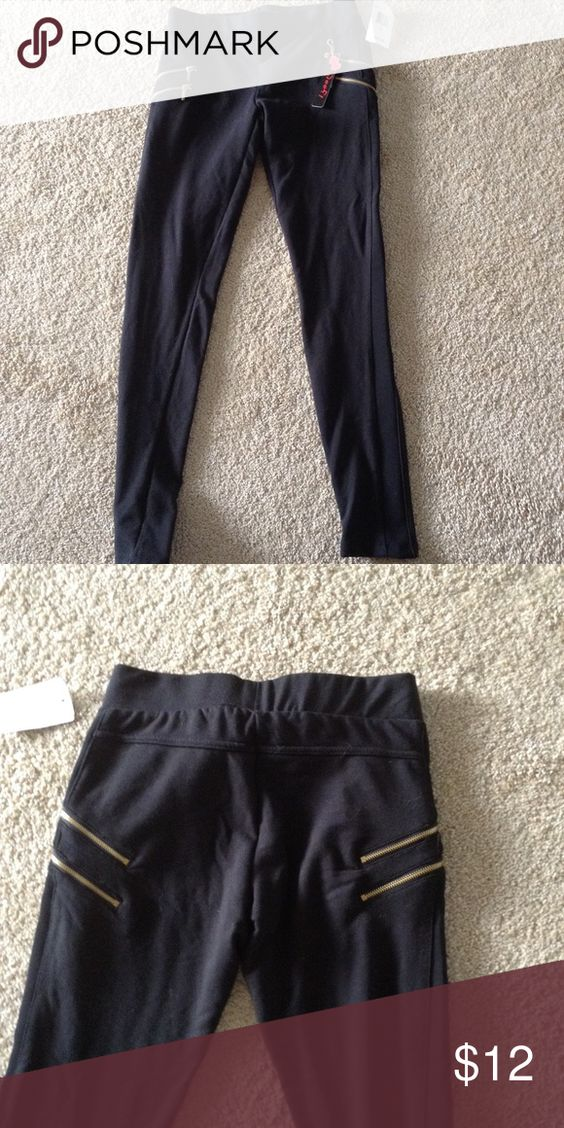 Leggings with gold zippers Black leggings with gold zippers size S.  Has spandex strip down sides.  Second pic is the back.  New with tags. Pants Leggings