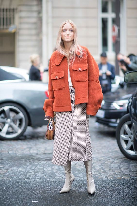 paris fashion week street style spring 2018 charlotte groeneveld orange jacket checked midi skirt white t shirt chloe bag cream sock boots getty images