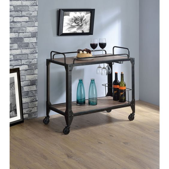 Serve guests easily with this portable cart. This wheeled cart features…