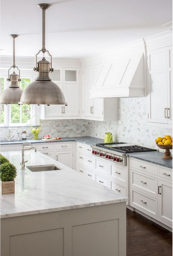 Pale soapstone countertops paired with white marble definitely look great. In this kitchen the soapstone provides the only color accent in this otherwise white on white kitchen, which makes it stand out even more.