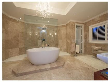 The shape of the tub and the chandelier is a nice touch! Adds a bit of glamour to the room