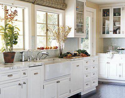 I love the back splash in this white kitchen