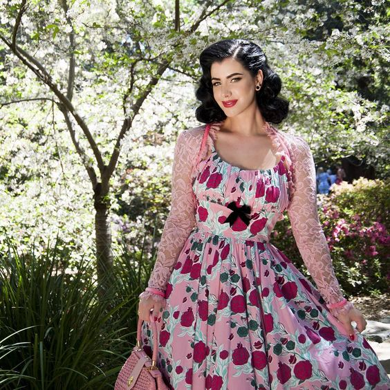"""Pinup Girl Clothing on Instagram: """"Continuing our pretty in pink with Laura Byrnes California Gothic Lace Bolero. Pair it with the #maryblair Ella or Evangeline in the pink lips and roses print for a truly beautiful look in sizes XS - 4X now at www.pinupgirlclothing.com. Model: @missvictoryviolet <3 Micheline #pinupgirlclothing #pinupgirlstyle #vintageinspired #pinupstyle #laurabyrnescalifornia #maryblair #coutureforeverybody #bodypositive #noveltyprint"""""""