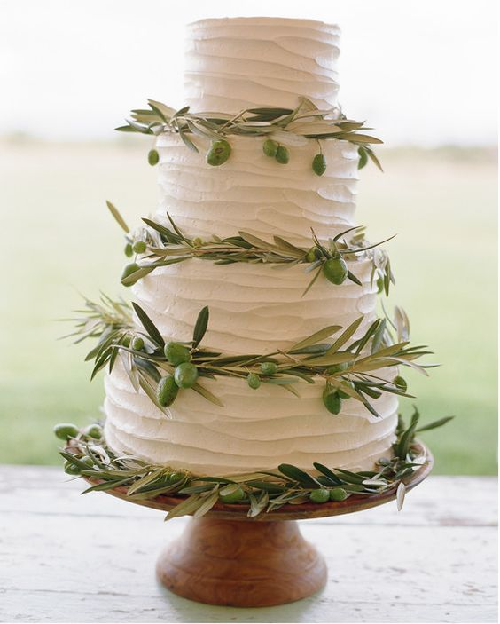 A huckleberry cake with buttercream frosting from Persephone Bakery nodded to the rustic décor at Callie and Eric's ranch wedding in Wyoming. Greenery adorned each tier, adding an earthy touch.