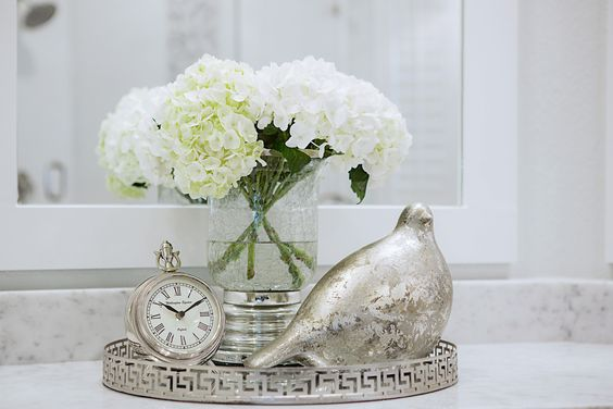 Master bath remodel.  Brushed nickel mirrored tray, silver clock, silver leaf vase and dove and beautiful hydrangeas were the perfect accents for this master bath retreat