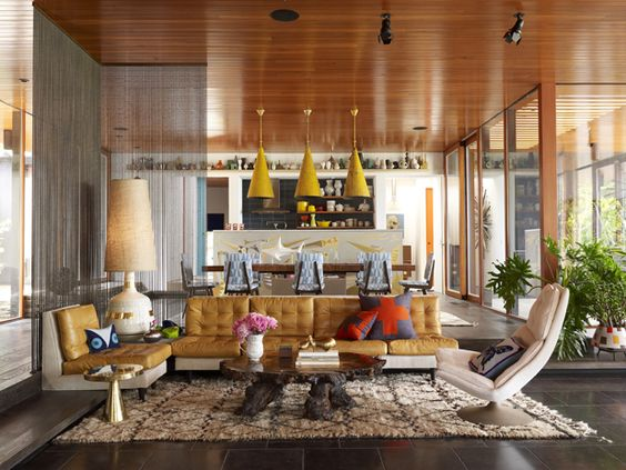 The sunken living room features area rugs designed by Adler, and the white table lamp was a prototype for his line of lighting.   - Veranda.com