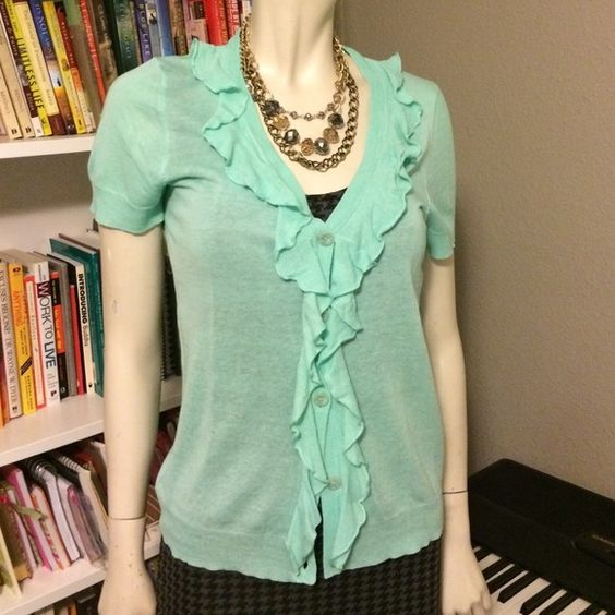 J Crew Short Sleeve Cardi Cute, soft mint green cardigan. Short sleeves, semi-sheer, ruffles along front and collar. Great condition. J. Crew Sweaters Cardigans