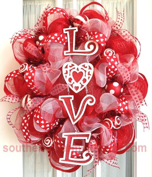 An oval deco mesh wreath for Valentine's Day! This oval wreath was made using a round wreath form.: