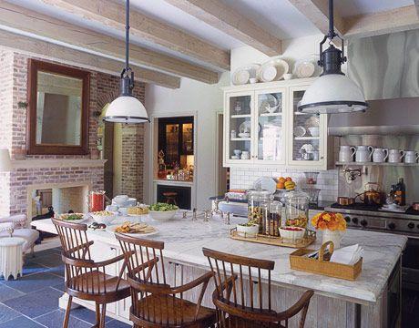 see-through fireplace, a wall of antique cedar bayou brick & an easy chair....charming!