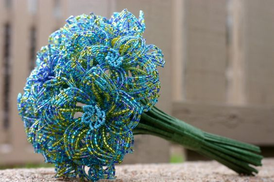 """This modern and elegant French Beaded flower wedding bouquet will be the perfect """"something blue"""" for any bride! This is made from blue, yellow, and green glass seed beads, crow beads, and Swarovski crystals. $70.00 I can has???"""