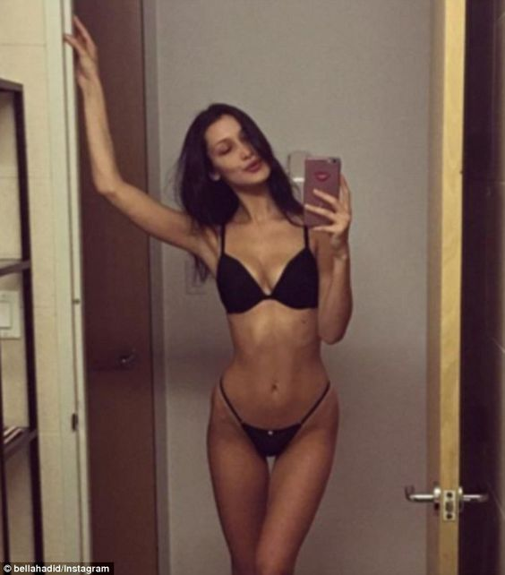 'Let's go!' Bella Hadid showed off her thin frame as she modeled lingerie while sharing he...: