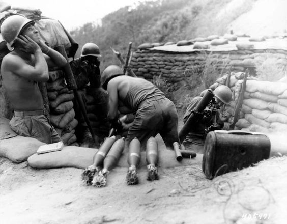 Members of the 81-mm Mortar Platoon, Co. D, 2nd Battalion, 5th Infantry Regiment, U.S. Eighth Army, blast Communist positions in Punchbowl, Korea.  12 August 1952.