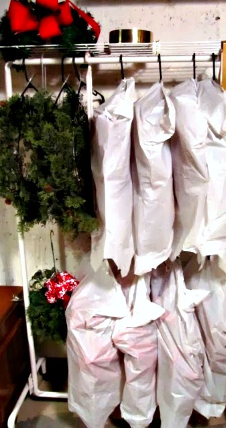 Wreath Storage ~ Using a Coat Rack, Zip Ties, Coat Hangers and Plastic Garbage Bag... Storing them properly is key to making them last for years