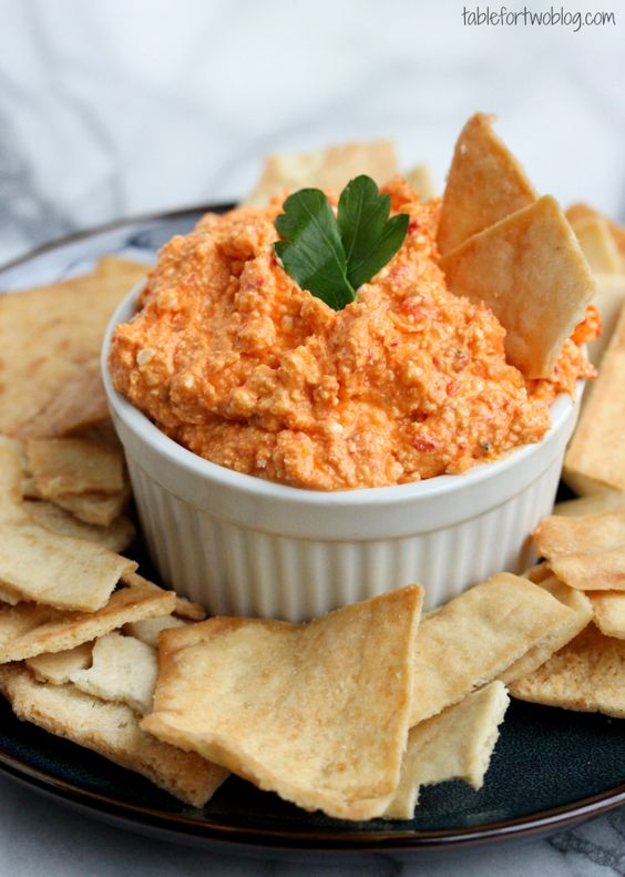 A Greek inspired dip of whipped feta and roasted red peppers from tablefortwoblog.com