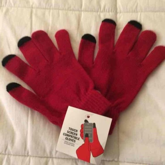 Red gloves, black tips, touch screen compatible! These tips make using your smartphone easy, even when it's cold out! Touchscreen compatible fashion gloves.  NWT  One size  **Bundle to save! Price accommodates shipping and fees!** Accessories Gloves & Mittens