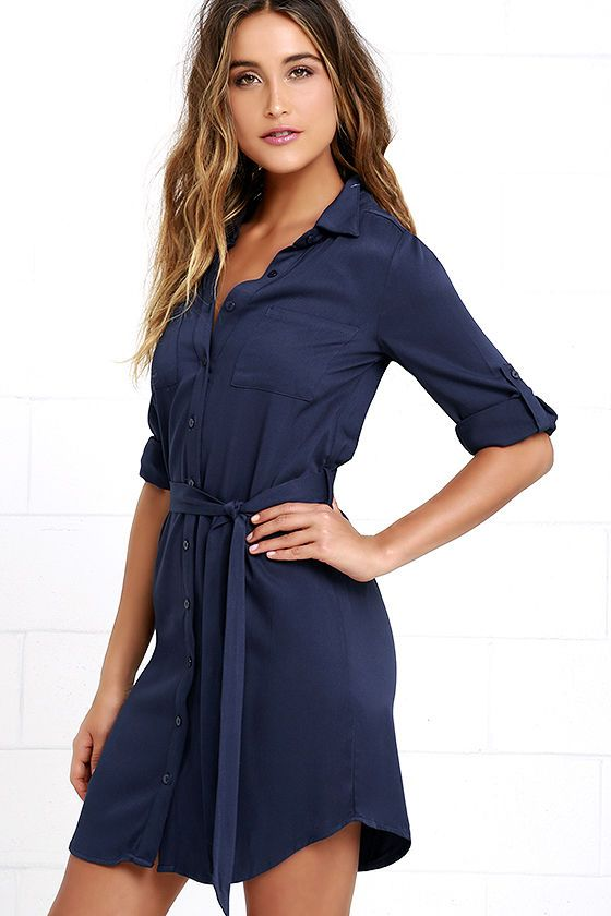 Treat yourself to some sophisticated style with the Acts of Love Navy Blue Shirt Dress! Woven cotton-blend fabric shapes a shift bodice with patch pockets, a collared neckline, button placket, and waist sash, all above the rounded hem. Three-quarter sleeves have hidden button tabs.