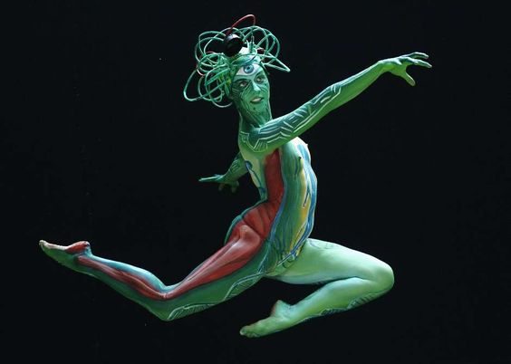 A dancer jumps as she poses during the annual World Bodypainting Festival in Poertschach