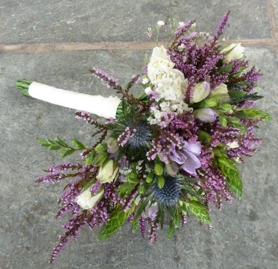Beautiful Brides Bouquet created with Spray Roses, Freesia, Eryngium, Gypsophilia, Chincherinchee and Heather.