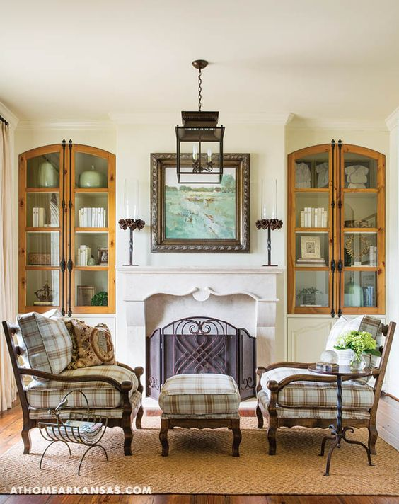 A mix of natural materials, including iron, wood, and stone mix with tranquil art, accents, and upholstery in the home's sitting room.   Riverside Reflection   At Home in Arkansas   July 2016   blue   beige   cream   European
