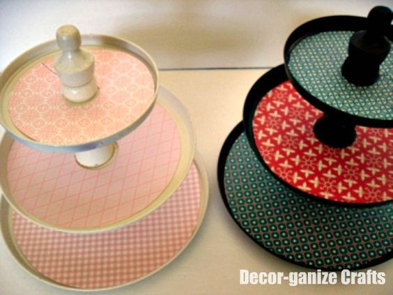 Cake Stands~~use metal burner covers & tin covers, wood finials, paint, and decorative paper to create.  DIY directions on site.