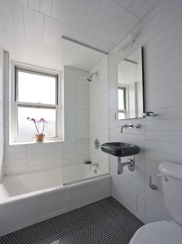 black floor tile  offset big wall tiles  Penny Tile Bathroom. Gray penny round flooring   beautiful    Ideas for Mom s Bathroom