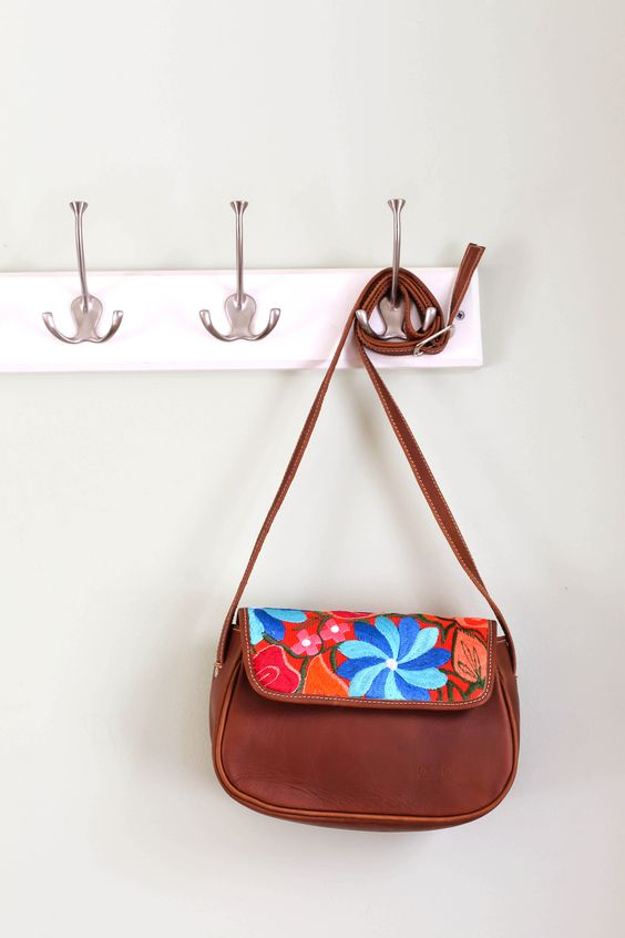 """•100% genuine leather •One zip pocket •Adjustable strap •Fabric liner •Hand embroidered huipil textile made from natural dyes •Handcrafted in Guatemala   9"""" x 6.3"""""""