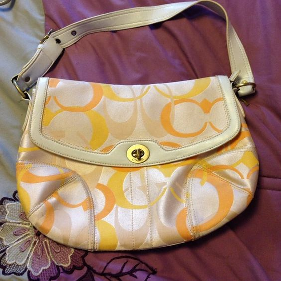 "Coach handbag Beautiful yellow ""C"" coach handbag. White leather strap and trim. Lays flat when closed. Used only a few times. Has additional pouch in back. Coach Bags"