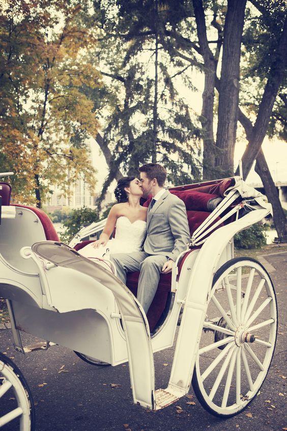 This couple takes a romantic horse  carriage ride! Photo by Kelly T. #WeddingPhotographersMN #WeddingIdeas #WeddingTransportation
