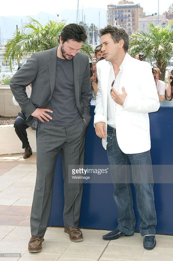 Keanu Reeves and Robert Downey Jr. during 2006 Cannes Film Festival - A Scanner Darkly Photocall at Palais des Festival Terrace in Cannes, France.