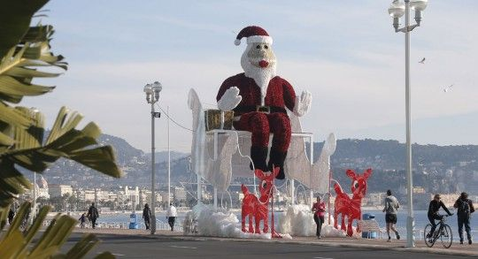 France: A giant Santa Claus sits in his sleigh on the Promenade des Anglais in Nice, France, on Dec. 14, 2013. (AP Photo/Lionel Cironneau)