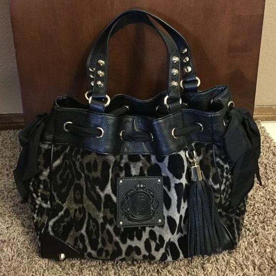 Juicy Couture Animal Print Handbag Used but still in great condition. It is a combination of black, dark gray, light gray, and has gold hardware. Medium to Large size. If you would like specific measurements please don't hesitate to ask. Inside is a dark blue and has no rips, stains, or shows any sign of wear. The outside is in great condition as well other than on the bottom corners where there is some slight wear shown in pic#4. Juicy Couture Bags Totes