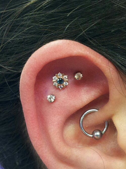 flat with flower and daith (pronounced doth) piercing.
