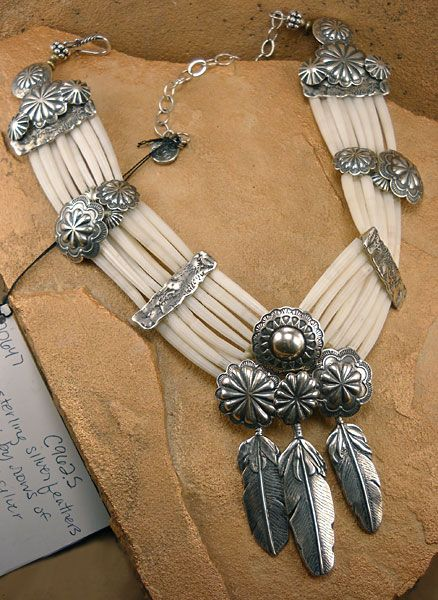 Necklace of Dentalium shells with three sterling Navajo feather dangles and silver Navajo buttons by The Mummy's Bundle