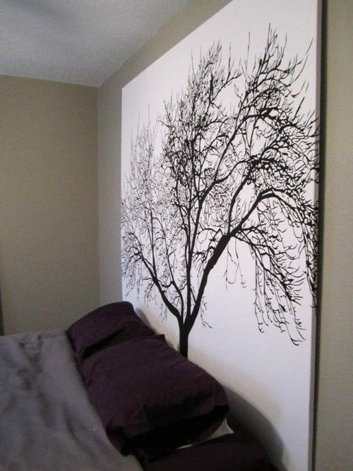 Brilliant! Staple a shower curtain to a wooden frame for inexpensive large scale artwork.