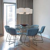 Bertoia chairs with covers.  black with white and grey covers.
