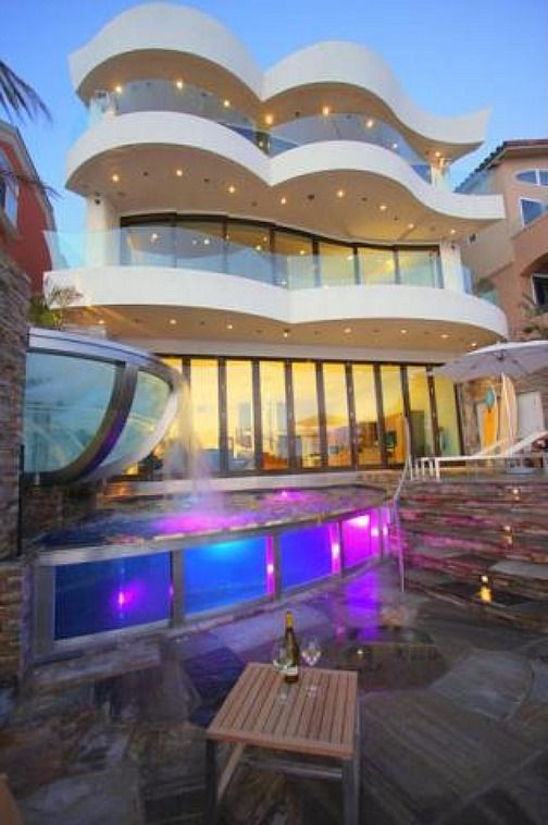 Big Beautiful Mansions With Pools This Beachfront Homeu0027s Dramatic Pool  Lights Up In Vivid Shades Of