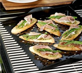 Grill Topper. Grilling = Manly. But sometimes what you're grilling is delicate. Prevent the smallest of foods from falling victim to the furnace below. Perfect for preparing bruschetta, delicate fish and vegetables. Nonstick coated.