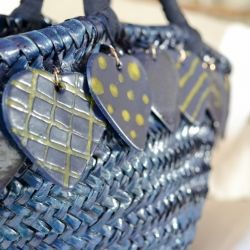 Use polymer clay to add charms to an old bag and  make it shine!