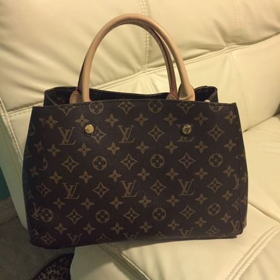 Nice purse. Used only twice. Brown and beige with logo purse. Bags Satchels