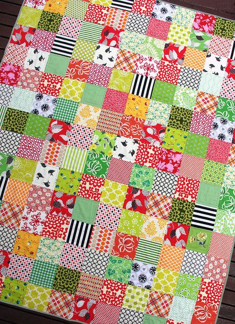 Summer Daze - The fabrics were cut as 5.5 inch squares, a total of 180 squares.  The finished quilt measures 60.5 inches x 75.5 inches.
