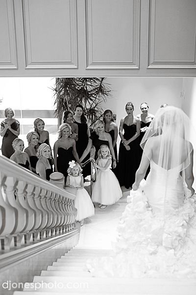 Bridal Party Photo - love this shot of the bridal party's reaction to the bride, fully dressed and ready, coming down stairs: