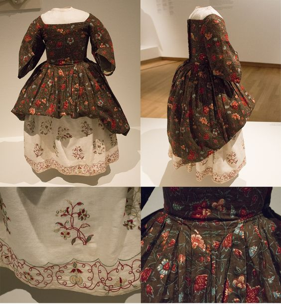 Girl's cotton dress (1700-1750), closing at the back. The petticoat is embroidered with silk on cotton in chintz-inspired flowers.