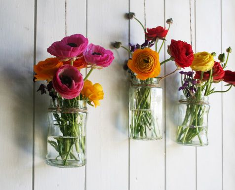 Flowers in jars on walls